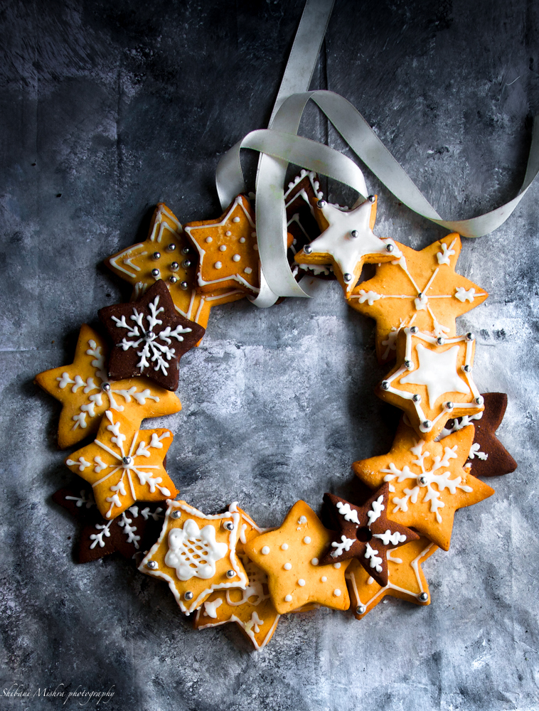celebrate Christmas with this delicious edible wreath made up of crunchy biscuits, beautifully decorated with white iced stars.