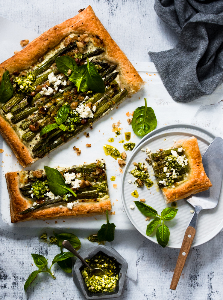 This asparagus ricotta tart served warm with chunky basil cashew pesto is a delight in itself and ideal spring weather treat.