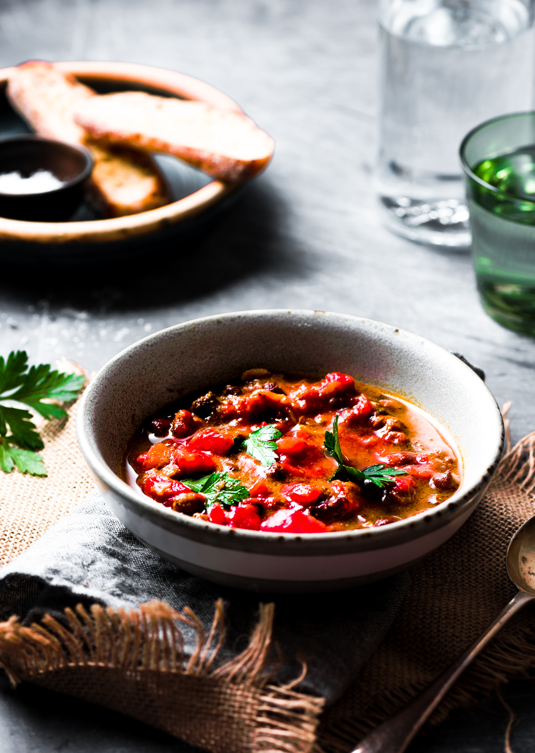 Winter is here and what you need is just to snuggle up and enjoy this hearty vibrant warm barley bean soup. A truly comforting soup.